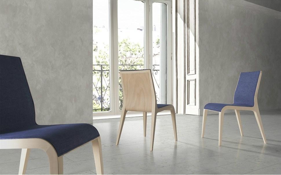 Silla ELLE con estructura cromada o lacada y tapizados a elegir.
